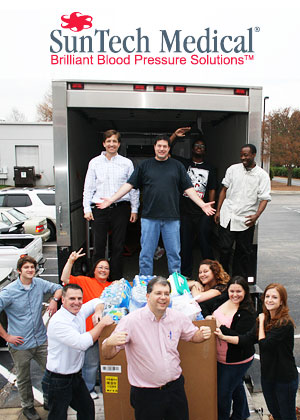 SunTech employees load food on a Food Bank truck
